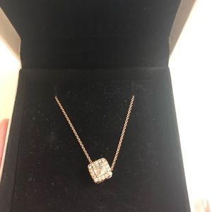 Pandora Rose gold necklace and a charm
